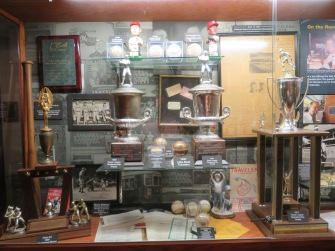 The 1977, 1979, and 1980 Texas League championship trophies dominate this case.