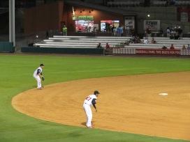 Arkansas Travelers second baseman Adam Law and shortstop Joey Wong in the field.