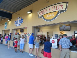A trio of concession stands: Shuck n' Cluck Chicken, Beacon Grill, and Pearl's Po' Boys.