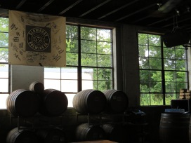 The brewery's barrel program with a banner signed by the brewery's contributors.