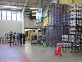 An overview of the brewery's can and keg storage.