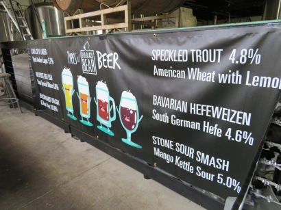 An old banner in the production building detailing the brewery's beers.