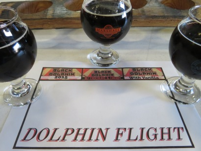 """A flight of the """"Black Dolphin"""" beers."""