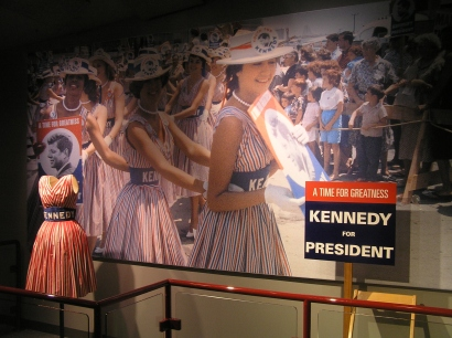 """The """"1960 Presidential Election"""" exhibit features dresses that women wore to promote Kennedy's candidacy."""