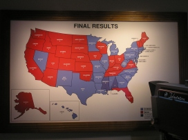 """The """"1960 Presidential Election"""" exhibit features a map of the Electoral College showing Kennedy's path to the presidency."""