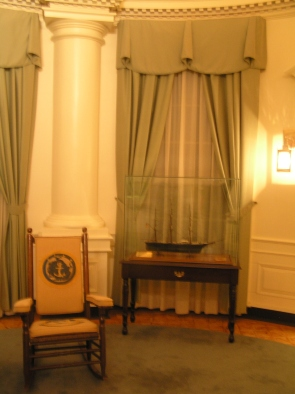 """""""The Oval Office"""" exhibit includes a rocking chair presented to Kennedy while aboard the U.S.S. Kitty Hawk."""