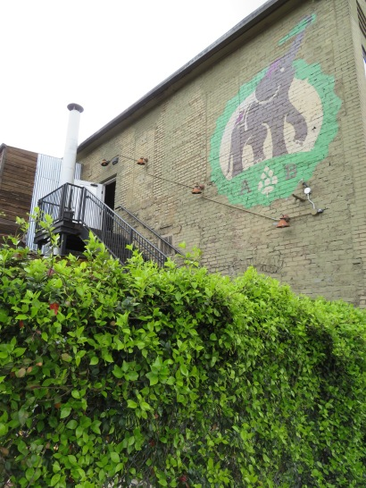 A view of the brewery's logo on the back of the building.