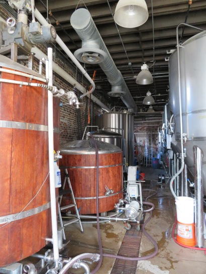 An overview of the brewhouse and fermentation tanks.