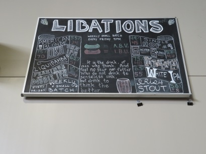 The hand-written beer board from the brewery's former location on 3rd Avenue South.