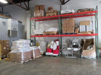 The brewery's storage area includes the bottling line and grains.