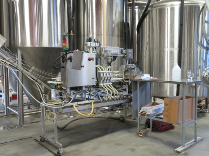 The canning line in front of fermentation tanks.