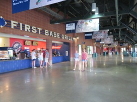 A concession stand along the first base line.