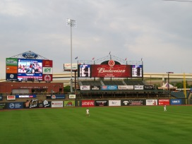 A view of the outfield with the main scoreboard in right field.