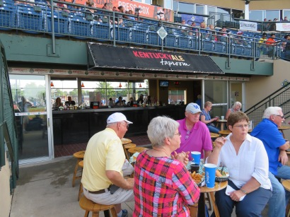 The seating area in front of the Kentucky Ale Taproom behind home plate.